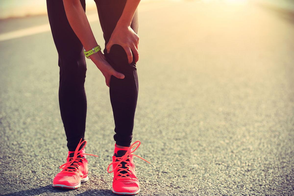 Runner holding their knee