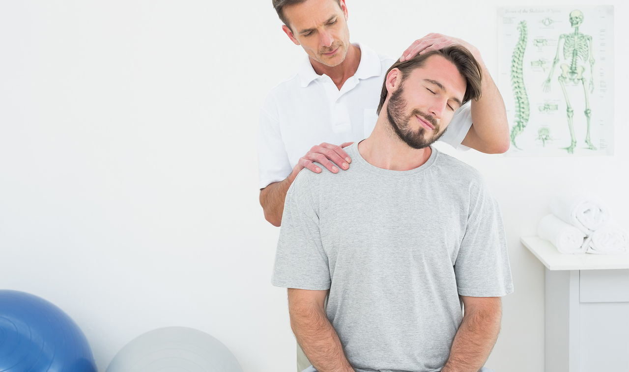 Chiropractor adjusting patient