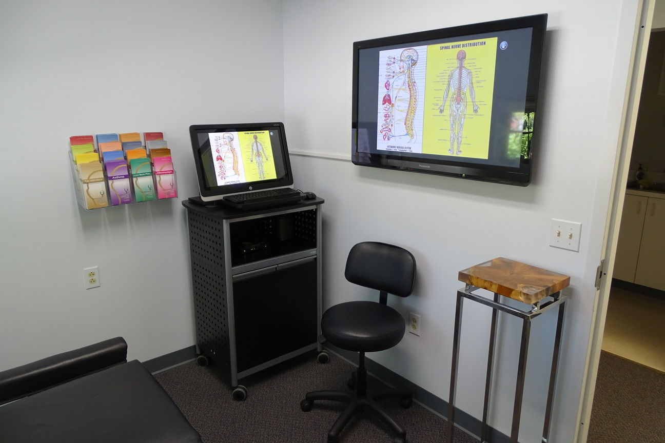room with monitor with educational diagrams