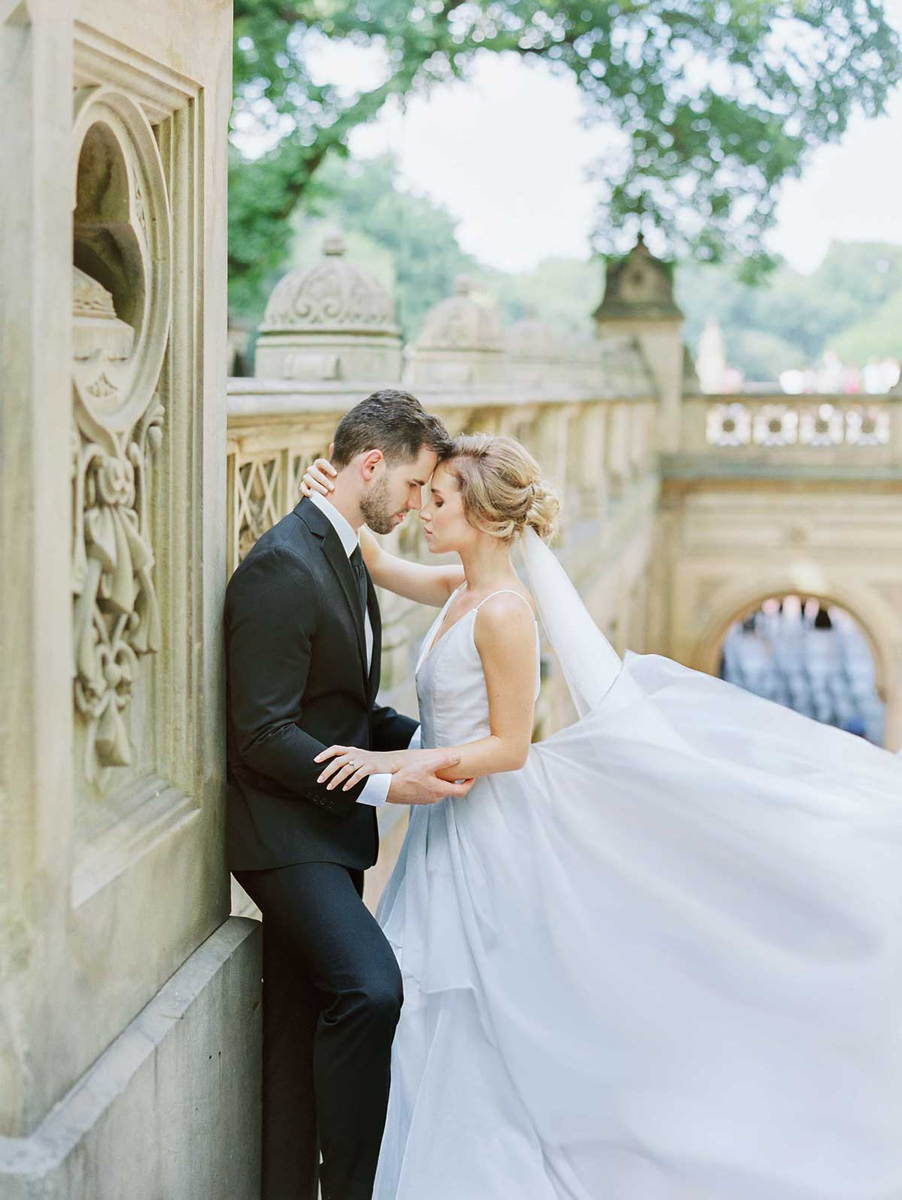 bride and groom kissing on the stairs