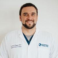 Dr. Adam Thompson