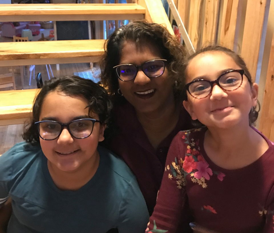 Dr. Elahi-Neal and daughters showing off their Draper James Mommy and Me frames