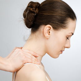 Closeup shot of a woman receiving a neck treatment