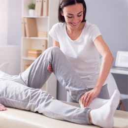 A chiropractor treats patient's ankle