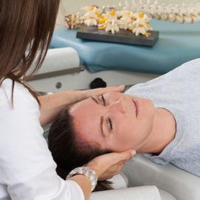 Woman receiving adjustment