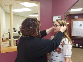 optometrist helping