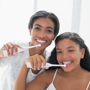 Mother brushing their teeth