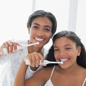 Women brushing their teeth