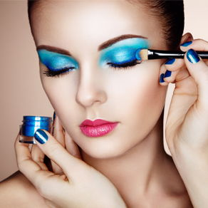 A model having blue makeup applied to her eyelids