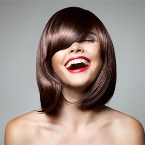 A model with shiny hair laughing