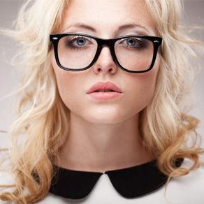 A head shot of a female model wearing large framed glasses