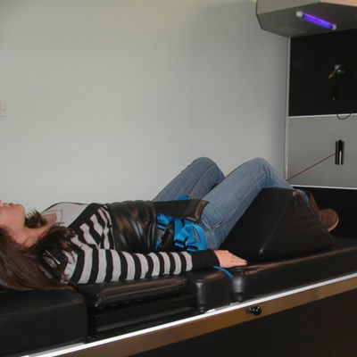 Patient using a spinal decompression machine
