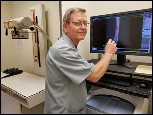 Dr. Fontaine examines a digital xray.