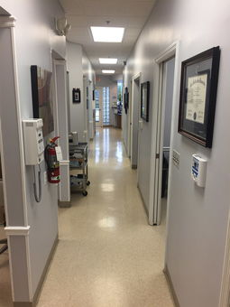 Hallway within the dental practice showing many different patient areas