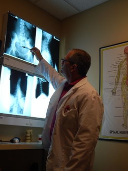 Dr. Greg reviewing X-rays