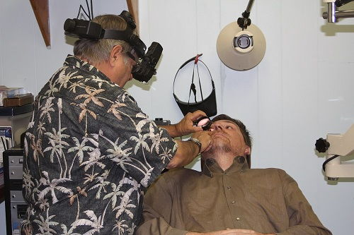 optometrist in Buena Park during an eye exam with a patient