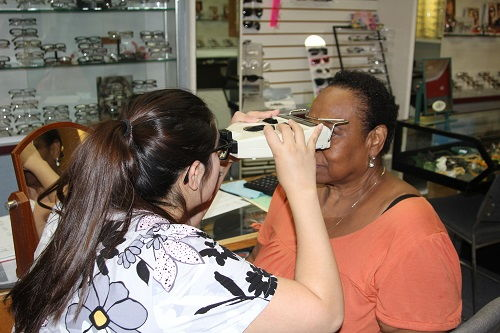 Optometrist treating a patient at Buena Park Eyecare