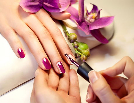 Image of a person having nails painted pink