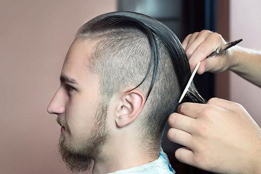 Close shot of a man receiving a haircut