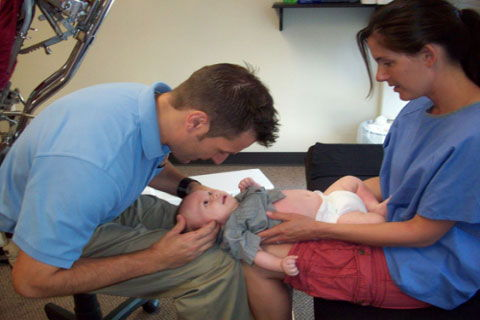 DR. ROSS ADJUSTING A BABY