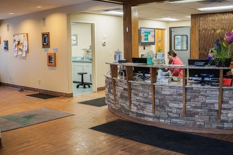 Reception desk and staff in lobby.